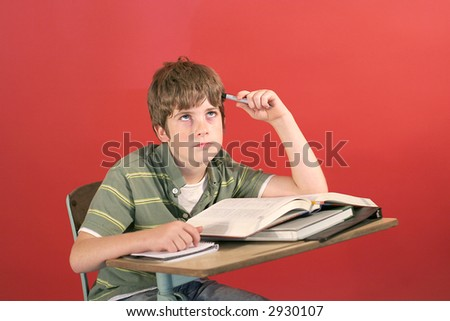 frustrated student at his desk - stock photo