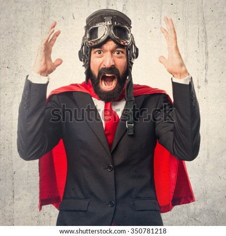 Frustrated super hero businessman - stock photo