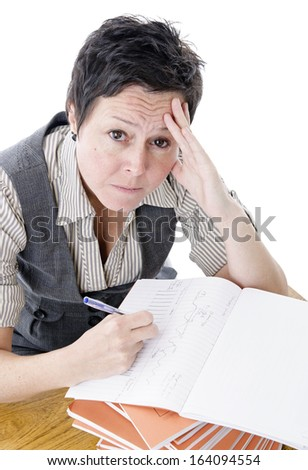 frustrated teacher marking students work - stock photo
