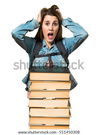 Frustrated teen student girl with a lot of books