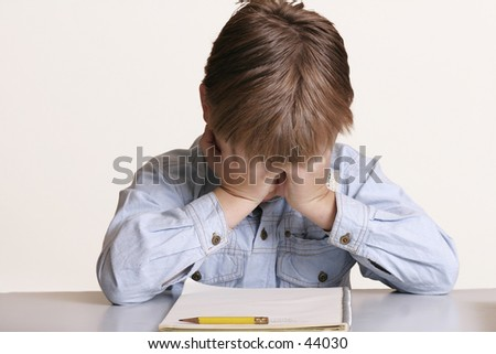 Frustrated with school or child with learning difficulties - stock photo