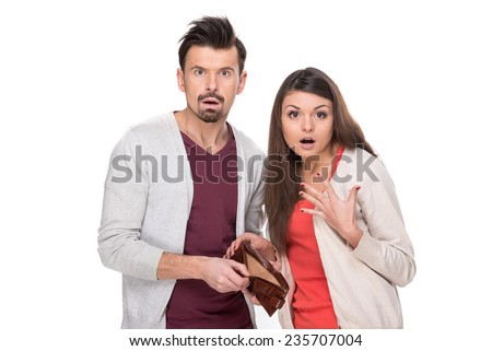 Frustrated young couple with an empty wallet, isolated on white background. - stock photo