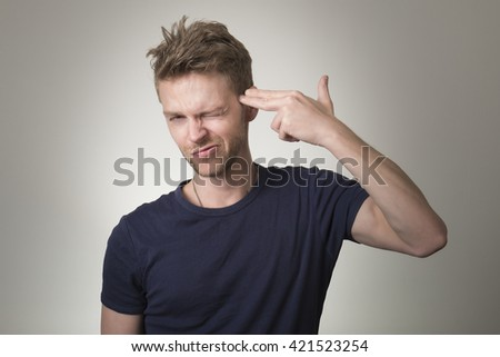Frustrated young man - stock photo