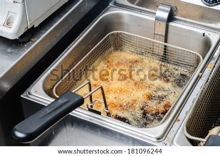 frying junk food in old oil is wrong and unhealthy - stock photo