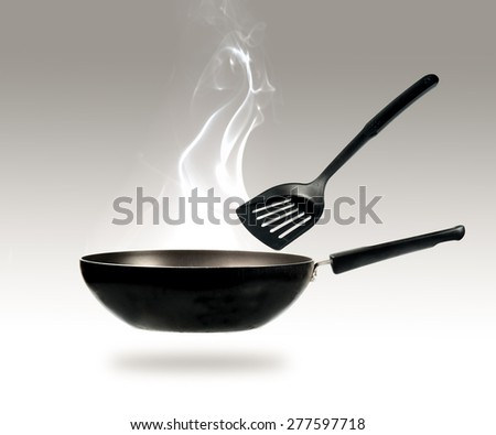 frying pan and smokw in kitchen - stock photo