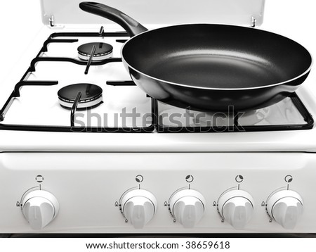 frying pan on the white gas cooker - stock photo