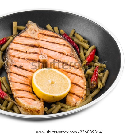 Frying pan with salmon steak. Whole background. - stock photo