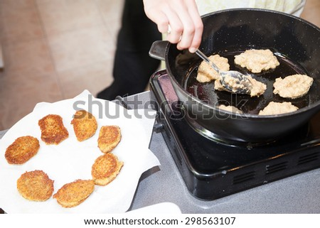 frying vegetarian cutlets from lentil on frying pan