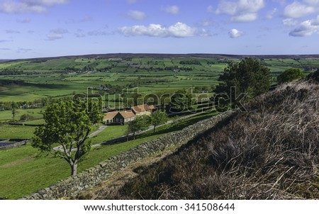 Fryup, Yorkshire, UK. North York Moors National Park with a view across the dale at Fryup and a farmhouse with surrounding fields near Fryup, Yorkshire, UK. - stock photo