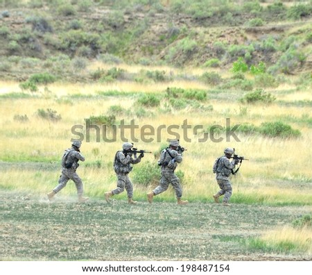 FT. CARSON, CO, USA, JUNE 7, 2014 The Colorado National Guard in partnership with Fort Carson conducted a (CALFEX) combined-arms live-fire exercise and public demonstration at Fort Carson.  - stock photo