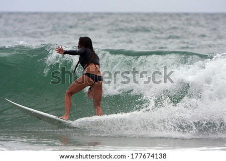 FT. LAUDERDALE, FL - DECEMBER 29:  A young female surfer rides a wave near the shoreline over the Christmas holiday break, on December 29, 2013 in Ft. Lauderdale, FL.