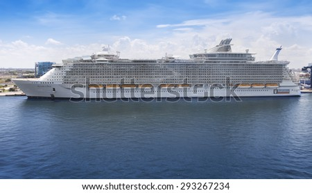 FT. LAUDERDALE, FL - JULY 10, 2011:  Royal Caribbean's, Allure of the Seas, anchored in Port Everglades. The Allure is 2.0 inches longer than her sister ship Oasis of the Seas, the largest ships. - stock photo