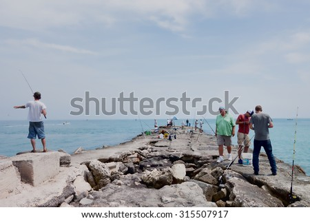 Ft, Pierce, FLORIDA - March 22, 2015: View of the pier in the Ft. Pierce inlet where people can enjoy sport fishing at their leisure