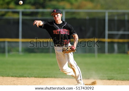 FT. WASHINGTON, PA - APRIL 23: Germantown Academy second baseman Dan Hoy makes a throw on defense against rival Malvern Prep on April 23, 2010 in Ft. Washington, PA - stock photo