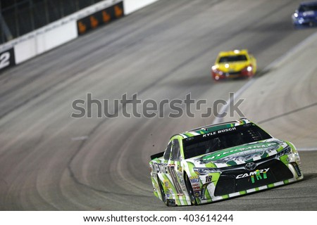 Ft. Worth, TX - Apr 09, 2016: Kyle Busch (18) battles for position during the Duck Commander 500 at the Texas Motor Speedway in Ft. Worth, TX. - stock photo