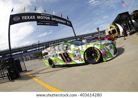 Ft. Worth, TX - Apr 07, 2016: Kyle Busch (18) brings his race car in for service during practice for the Duck Commander 500 at the Texas Motor Speedway in Ft. Worth, TX. - stock photo