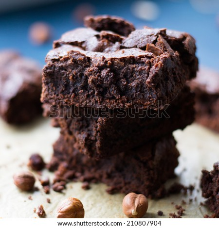 Fudgy Brownies on a wooden table - stock photo