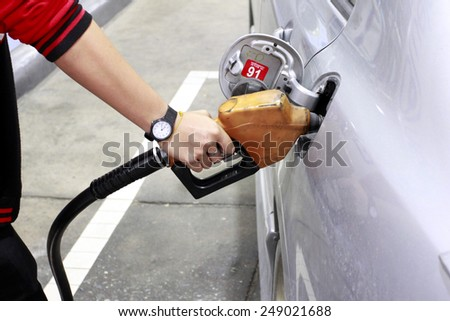 Fuel-filled in gas station - stock photo