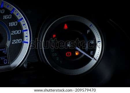 Fuel gauge empty close up at night - stock photo