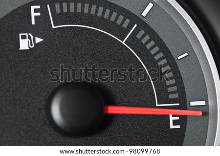 Fuel gauge with needle pointing to empty - stock photo