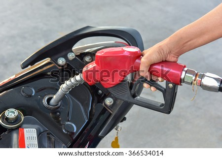 Fuel nozzle Car Gas Tank - Fueling Theme. Closeup Photo Collection