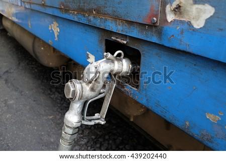 fuel nozzle for the train - stock photo