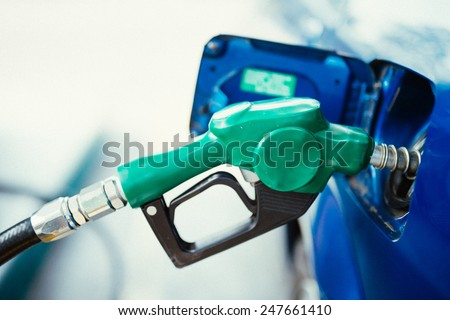 Fuel nozzle,gas station. - stock photo