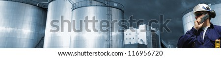 fuel storage towers and oil worker and sunset, extreme panoramic view - stock photo
