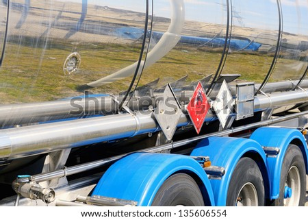 fuel tanker with warning sign - stock photo