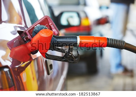 Fuel theme. dispenser pumping diesel or gasoline in car at gas station