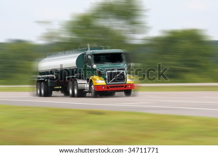 fuel truck in motion on interstate - stock photo