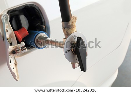 Fuel up the natural gas vehicle (CNG) for car - stock photo