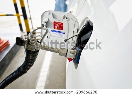 Fuel up the natural gas vehicle (NGV) at the station - stock photo