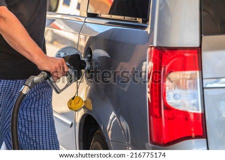 Fueling a car at petrol station. - stock photo