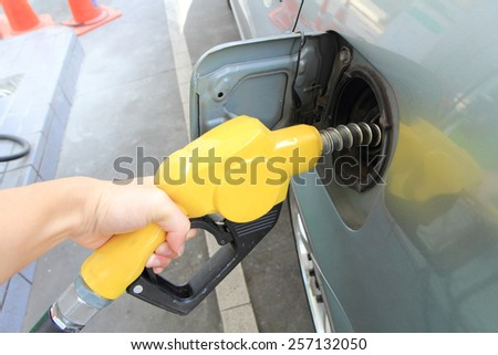fueling the petrol at the Petrol station