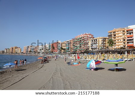 FUENGIROLA, SPAIN - AUG 16: Beach in mediterranean resort Fuengirola. August 16, 2012 in Fuengirola, Costa del Sol, Province of Malaga, Andalusia, Spain - stock photo