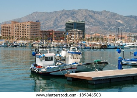 FUENGIROLA, SPAIN - JUNE 26, 2008 - Traditional fishing boats in the harbour, Fuengirola, Costa del Sol, Malaga Province, Andalucia, Spain, Western Europe, June 26, 2008.