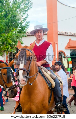 Fuengirola, Spain - October 10, 2014: Unidentified elderly man mounted on a horse wearing traditional Andalusian clothes during annual fair in Fuengirola.