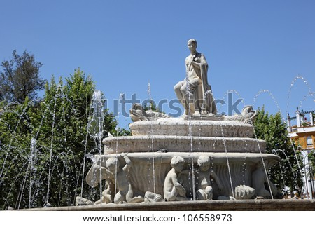 Fuente de Sevilla fountain at the Puerta de Jerez square in Seville, Andalusia Spain