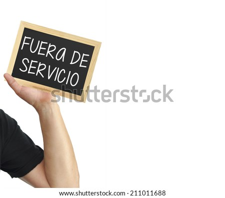 Fuera de Servicio (Out of Service in Castellano Spanish) Blackboard Sign held in hands isolated on white background