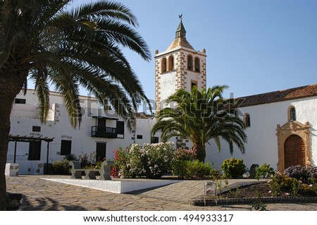 FUERTEVENTURA, CANARY ISLANDS - AUGUST 18, 2004: Area gardens and church of Santa María, in the historic village of Betancuria