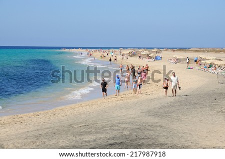 FUERTEVENTURA, SPAIN - MAY 30: People walking on the beautiful white sand beach Jandia Playa. May 30, 2009 on Canary Island Fuerteventura, Province Las Palmas, Spain
