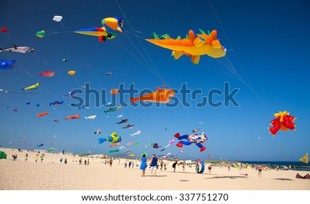 FUERTEVENTURA, SPAIN - NOVEMBER 8: Viewers watch from the ground as colorful kites fill the sky at 28th International Kite Festival, November 8, 2015  in Dunes of Corralejo, Fuerteventura, Spain