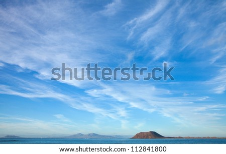Fuerteventura, view towards Isla de Lobos and Lanzarote, natural background of predominantly sky - stock photo