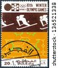 """FUJAIRAH EMIRATE - CIRCA 1972: A stamp printed in United Arab Emirates from the """"Winter Olympic Games - Sapporo, Japan"""" issue shows Slalom skier, circa 1972. - stock photo"""