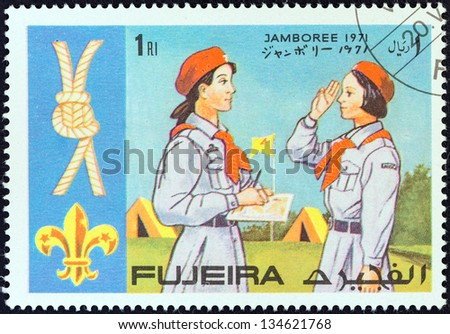 "FUJAIRAH EMIRATE - CIRCA 1971: A stamp printed in United Arab Emirates from the ""World boy scout jamboree"" issue shows scouts and knot, circa 1971. - stock photo"