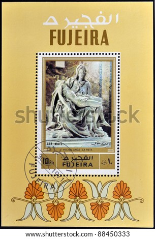 FUJEIRA - CIRCA 1971: A stamp printed in Fujeira shows The Pieta by Michelangelo, circa 1971 - stock photo
