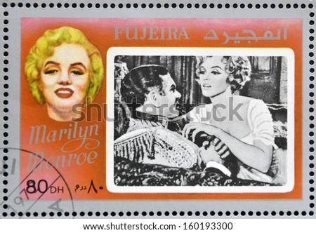FUJEIRA - CIRCA 1972 : stamp printed in Fujeira shows actress Marilyn Monroe, circa 1972  - stock photo
