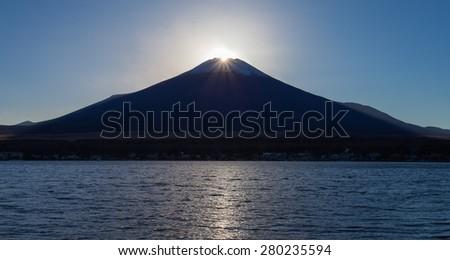Fuji diamond at Lake Yamanakako , Sunset at Top of Mountain Fuji  - stock photo