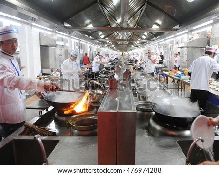 Restaurant Kitchen Chefs motion chefs chinese restaurant kitchen stock photo 587875190